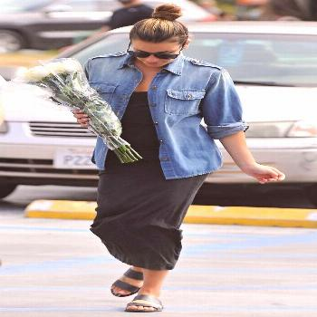 The outfit: Straight black tank dress  chambray shirt  slip-on sandalsWhy it works: Lea is just 53