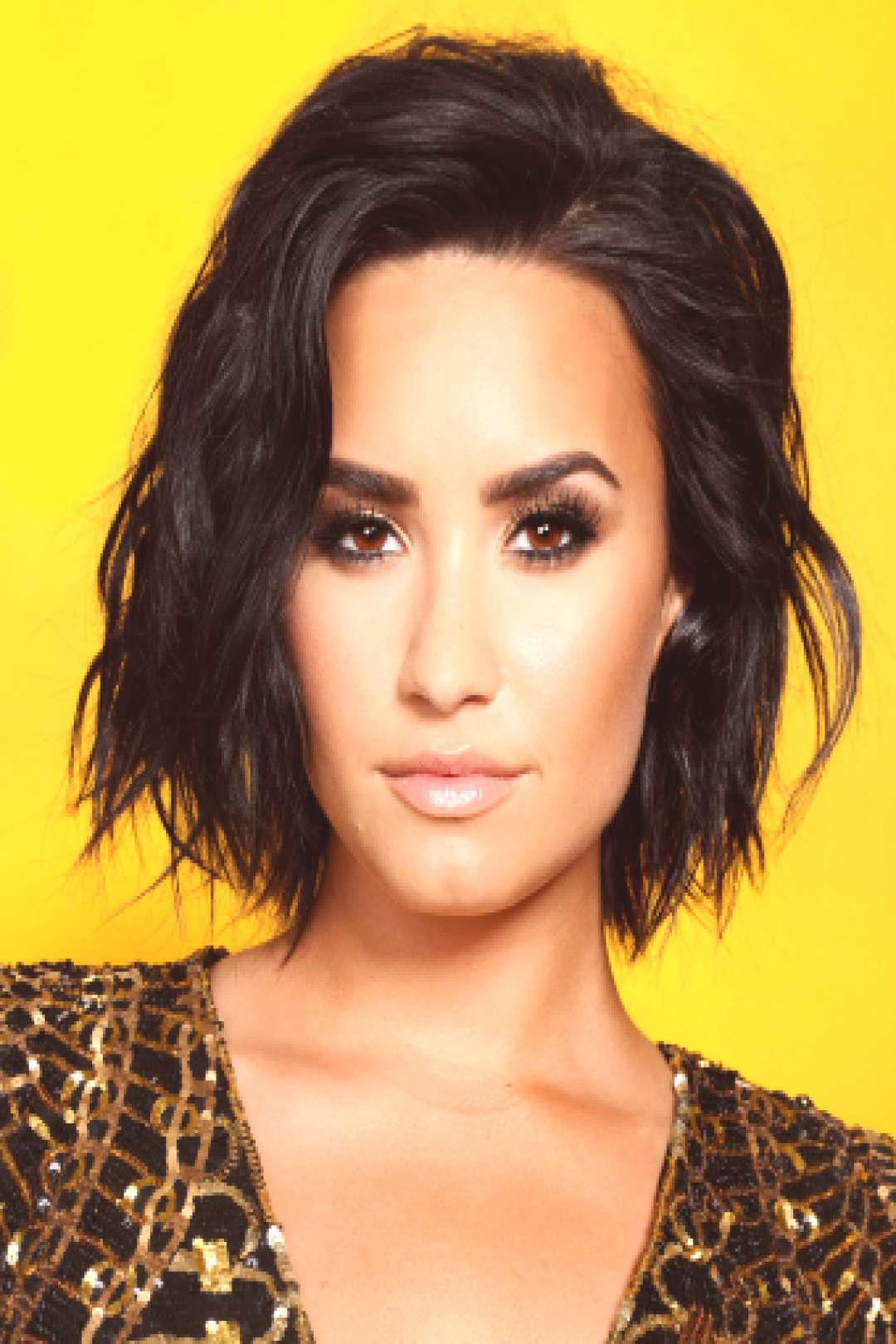 Demi Lovato is ROCKING the look from her camp days...